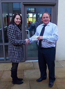 Charlie Middleton handing over cheque to TCT's Steve Oliver